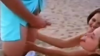 son having fun with his sister and mother on the beach